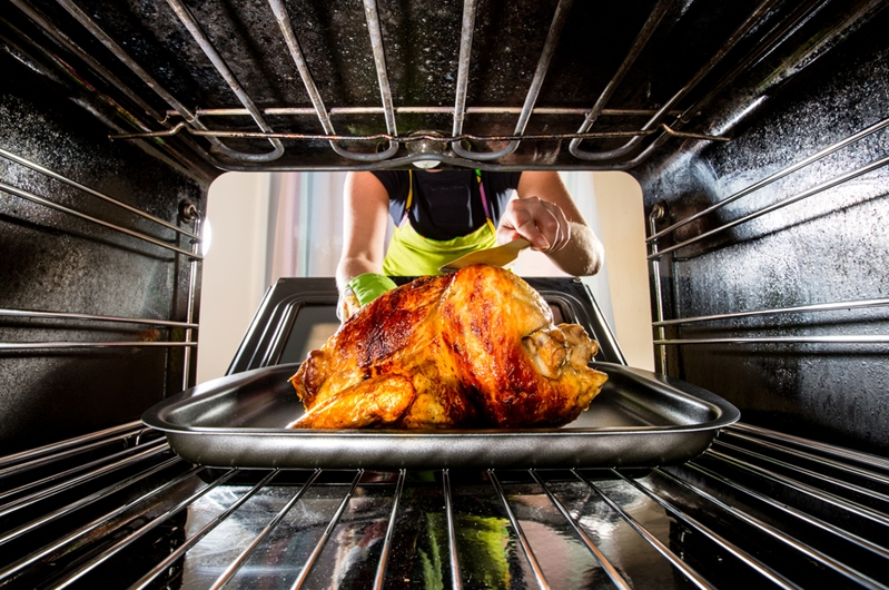 Regularly basting is a smart way to keep the bird moist and avoid a potential fire hazard.