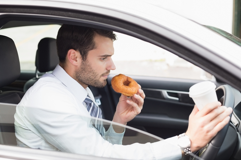 Eating behind the wheel is considered a secondary offense under the Driving Under the Influence of Electronics Act.